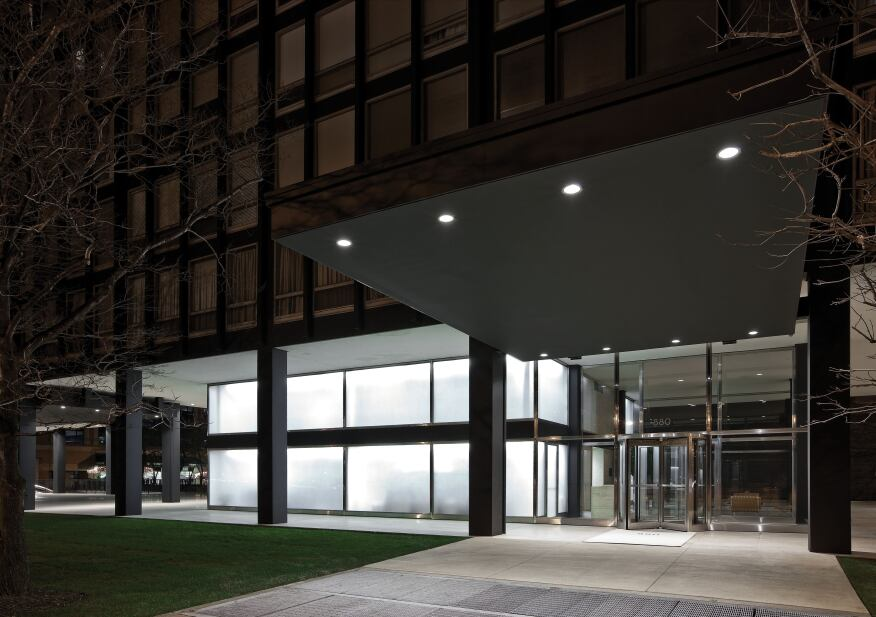 The lighting scheme achieves maximum effect with just two luminaires. Recessed downlights, now outfitted with 39W ceramic metal halide lamps to save energy, accent the lobby canopy, while T12 lamps in the original asymmetric linear fluorescent reflectors, designed by Kelly, backlight the glass to create the glowing effect.