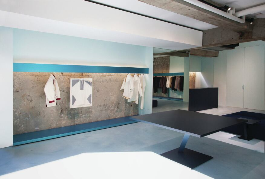 "The architects went through many color combinations before settling on green and blue for the aluminum clothing displays, because, Yoshioka says, those colors ""maximally evoke the texture of collections which will be contained at the store."" Blue racks are confined to the upper level."