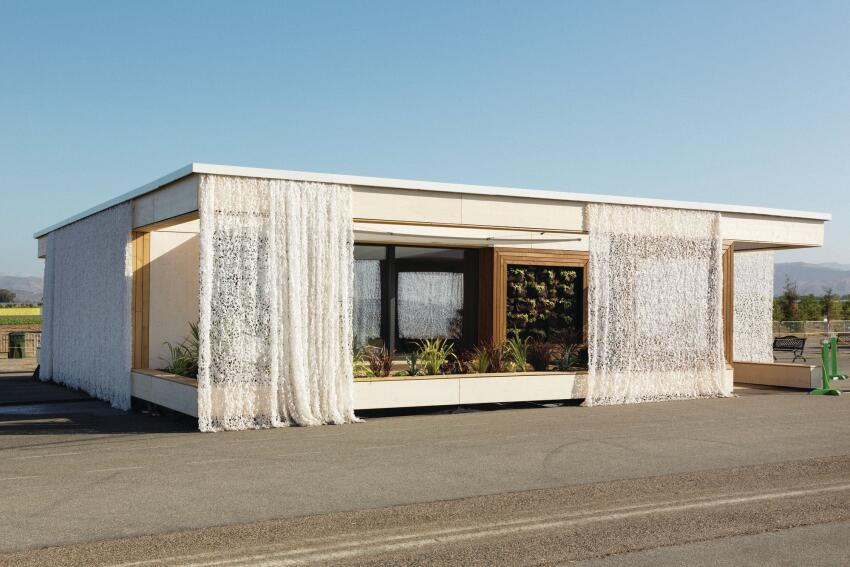 Team Austria's LISI house was the competition's overall winner. A decorative, laser-cut curtain wraps the exterior, adding an extra level of privacy and shade from the late afternoon sun.