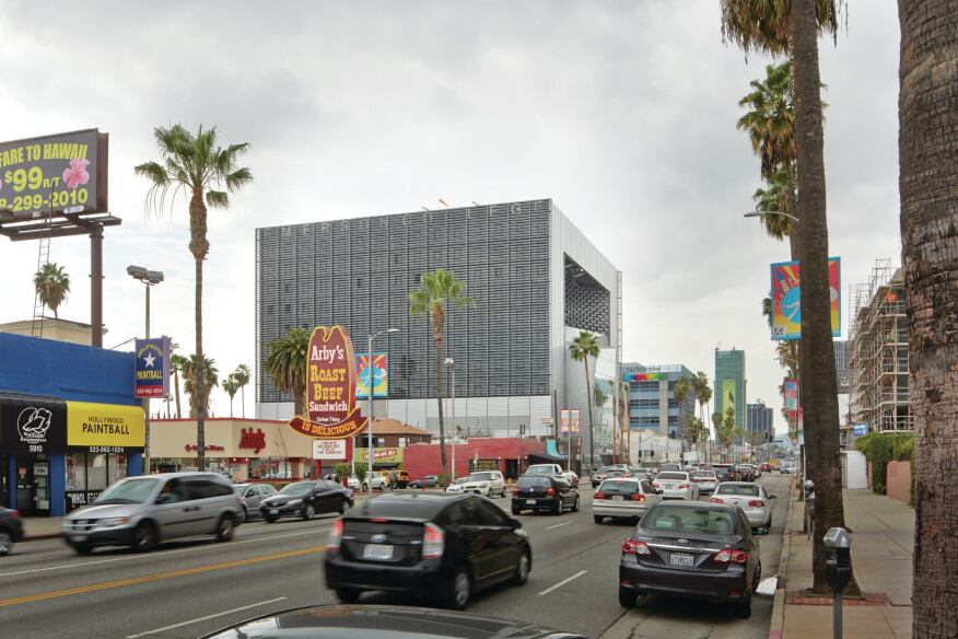 The building is located on a rapidly gentrifying commercial strip of Sunset Boulevard.