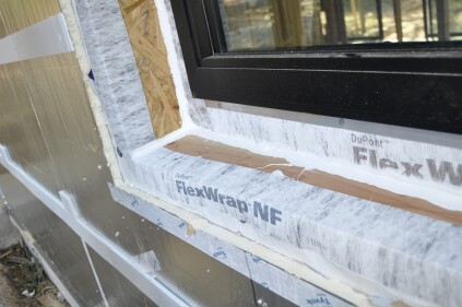 Next, Tyvek Flashing and Joint Compound is gun-applied into the corners.