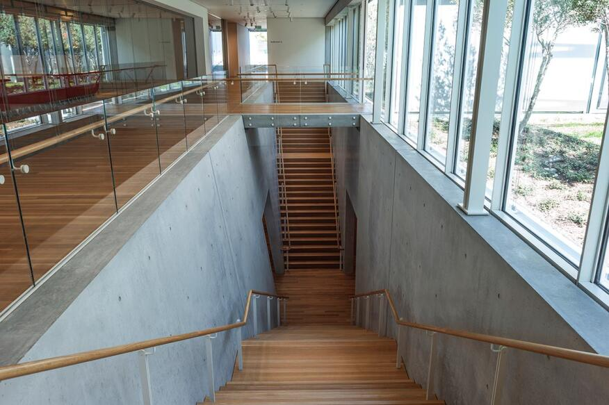 Double staircase leading down to the library and auditorium on the lower level. Photographed November 2013.