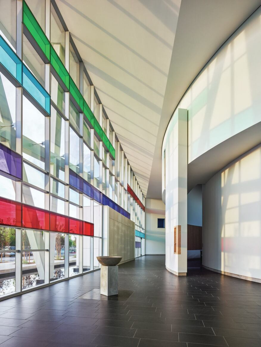 The angles of the façade, colored with Vanceva films from Eastman (see Curtainwall Light Box Detail), distort around the sanctuary's curvilinear walls.
