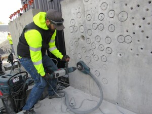 This SDS-max rotary hammer is teamed with a dust collection system for drilling cores.