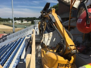 The Brokk 100's 13-foot reach, coupled with the Darda CC340 concrete crusher's 37 tons of power, allowed the operator to demolish the majority of the walls around the machine.