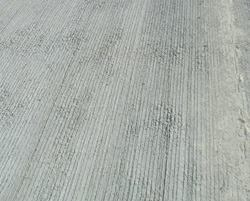 Tining reduces tire noise on concrete pavements. You can best accomplish the deadening effect when the tining pattern is consistent. On this project, variations in mix consistency made it difficult for the pavement contractor to complete the tining pattern.