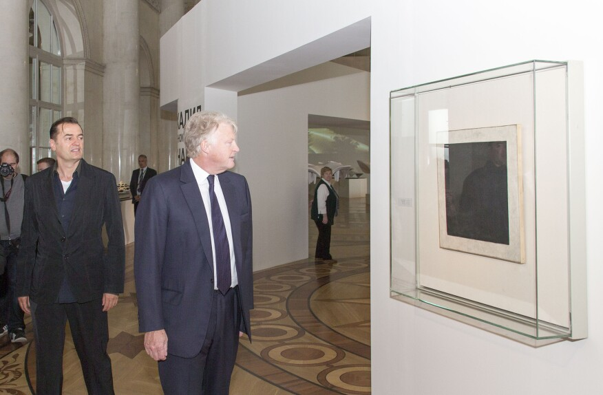 """Malevich's """"Black Square,"""" mounted by the exhibition entrance"""