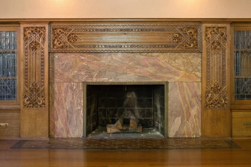 The library fireplace.