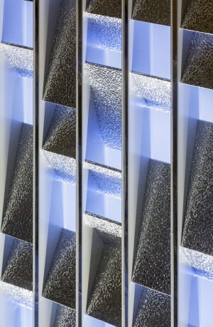A detail of the peened aluminum reflectors that are used for the facade.