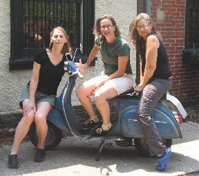 Not your father's remodelers: Priesing (left) and Menke (center) on Myers' Vespa.