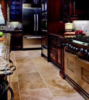 KITCHEN CONFIDENTIAL: A wide variety of appliances from Whirlpool Corp. converge in the pinnacle  of convenience. A KitchenAid Architect Series range offers electric and gas  cooking options and features 3.25 cubic feet of oven capacity. The double-oven  cooks with true convection technology, and the bottom-freezer refrigerator  has French-door styling for full-width storage.