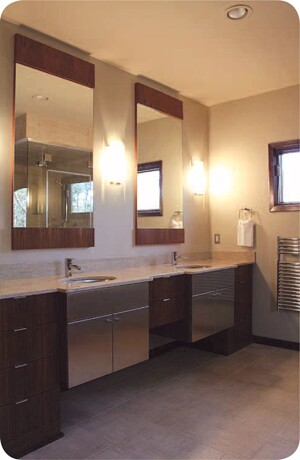 Designer Zack Simmons says this bathroom reflects the blend of traditional and modern elements that his clients prefer. He used teak wood veneer and stainless steel on the cabinet doors.