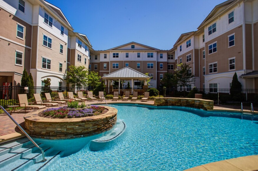 Residents of Campus Crossings' Briarcliff apartments in Atlanta enjoy a large outdoor pool.
