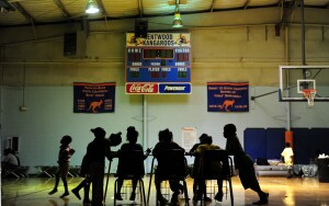 Children try to do their homework at an evacuation shelter in a high school gymnasium in Kentwood, northeast of New Orleans on August 30, 2012 in Louisiana, where Tropical Storm Isaac has dumped more rain onto an already saturated Gulf Coast leaving residents to seek safety from flooding. Authorities in two states along the US Gulf Coast urged residents to seek shelter amid fears the Percy Quin dam in Mississippi near the Louisiana border showed signs of damage due to the storm. AFP PHOTO / Frederic J. BROWN        (Photo credit should read FREDERIC J. BROWN/AFP/GettyImages)