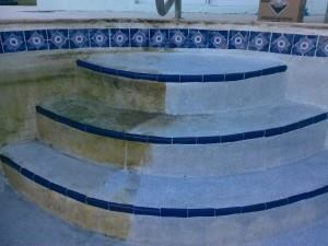 First step: It is recommended that acid washing begin on raised horizontal surfaces such as stairs or ledges to allow extra care. The acid has more time to eat away at plaster if not washed away properly.