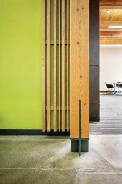 Hennebery Eddy specified structure-as-finish detailing for columns and beams and used standard platform wood framing (nailed studs) behind painted gypsum wallboard or western hemlock 1x boards.