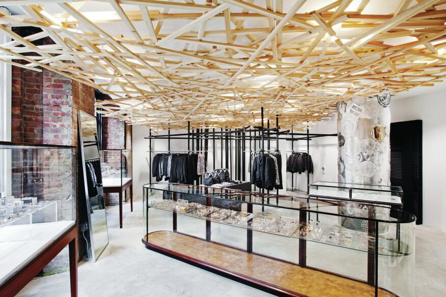 The ground floor space (the building's original windows on the left) for the jewelry shop and Black Comme des Garçons, a lower-priced line. The ceiling was designed by Rei Kawakubo.
