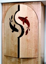 Yin and yang arched doors are inlayed with fish of macore wood.