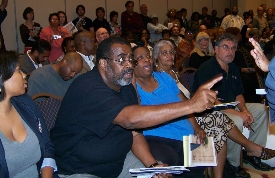 "Detroit resident Raynard Davis confronts then-Mayor Dave Bing at a 2010 community forum to discuss the Detroit Works plan. ""Why are you talking about shrinking the city instead of growing the city?"" Davis asked."