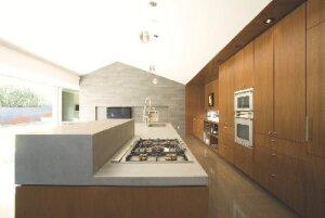 The kitchen features concrete flooring and custom cabinets made from formaldehyde-free plywood.