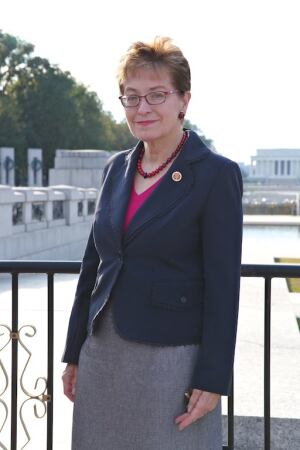 Rep. Kaptur standing in front of the closed WWII Memorial, some of which you can see behind her. Also, across the memorial and the long reflecting pool, you can see the Lincoln Memorial, which is also closed because of the federal government shutdown.