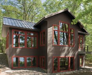 """""""The only drawback [of fiberglass siding] is the cost. But if you have a value-conscious buyer, that's not a drawback,"""" says Bruce Peter, Just Exteriors, N.Y."""