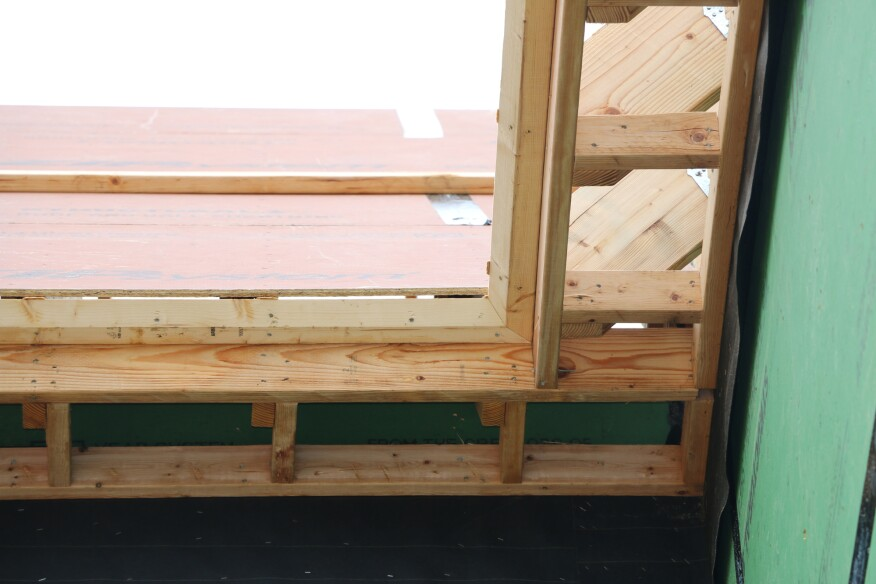 Blocking next to each rafter spans between the subfascia and the ledger. The angled crown backer fits against the subfascia and the horizontal cut of the rafters. The backer is mitered at all inside and outside corners.