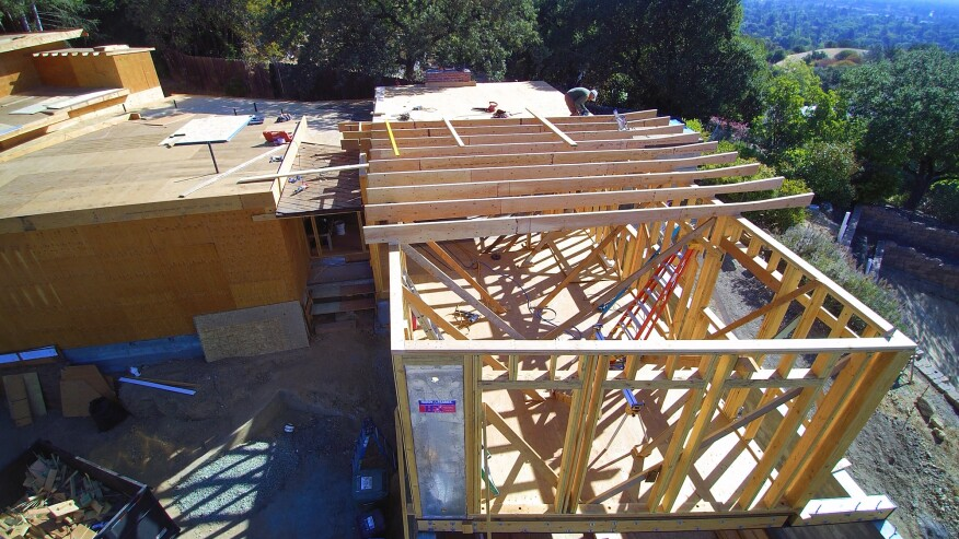 Custom-ripped LVL rafters create a slope toward the gutter from both the center and the edge of the roof.