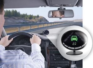 Mobileye Inc. offers camera-based safety solutions such as the AWS-4000, which includes a smart camera that's installed on the inside front of a windshield (as shown above) and uses advanced vision technologies to detect and measure distances to lanes and vehicles and traveling speeds. When lane departures without signaling occur or potential forward collisions are detected, the system warns drivers with audiovisual alerts. Photos: Mobileye Inc.
