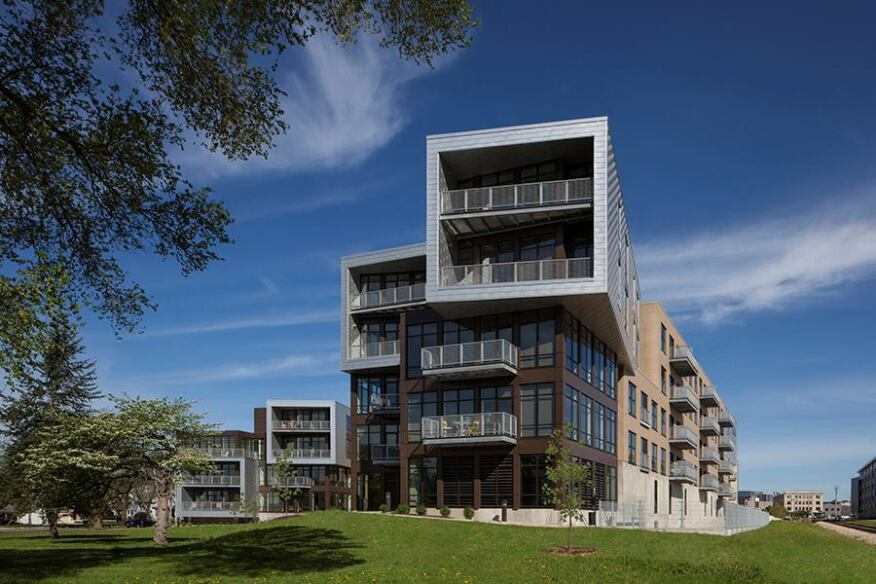 The building's cantilevered wings, designed to make the property look less dense, also add visual dramato the elevation.