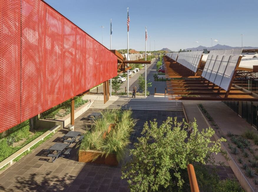 Cor-Ten steel canopies line the landscaped plaza between the long, barlike structures at Mariposa that hold offices, processing, and port facilities. Steel scuppers and a rainwater harvesting system from StormTech funnel run off into a million-gallon cistern under the site.