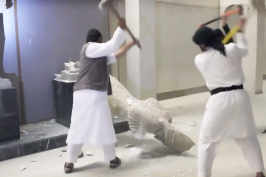 Still from a video that ISIS produced and distributed, showing its destruction of artifacts in a Mosul, Iraq,museum.