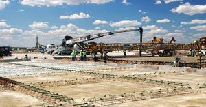 Workers cast 17-in.-thick taxiways as part of a 3000-ft. runway extension for the O'Hare Modernization Program.
