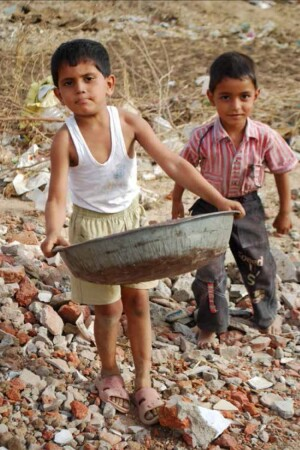 Kids ranging from ages 3 to 16 helped collect rocks for the walls.