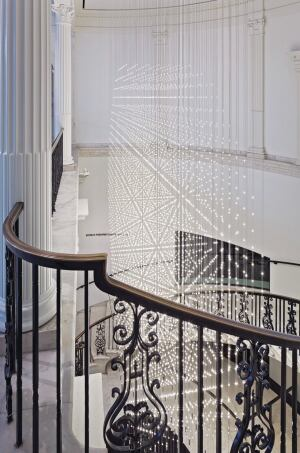 As viewers spiral the rotunda's marble staircase, the installation appears to shoot star bursts in all directions due to the designers' strategic use of the moiré effect. Starlight comprises 219 strands of wires, or vines, that total 3 miles in length.