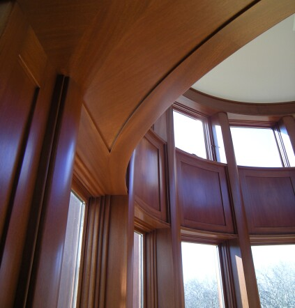 The second-floor room was trimmed with solid mahogany column covers, stiles, and rails, and flitch-matched veneered panels.