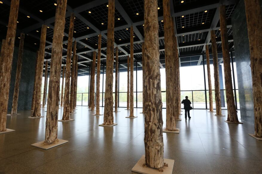 """David Chipperfield's """"Sticks and Stones"""" installation at the Neue Nationalgalerie in Berlin consists of 144 tree trunks. The British architect is on deck to renovate the gallery, originally designed by Ludwig Mies van der Rohe, next year."""