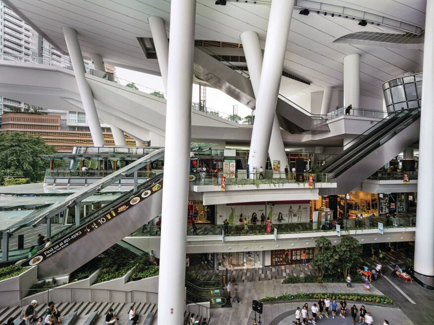 Upon entering the open air mall on the building's lower levels, visitors can descend into a series of sunken plazas, or begin a journey up a series of switch-back escalators that leads to the upper civic and performing arts levels.
