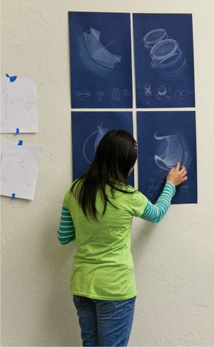 A student at the California Lighting Technology Center at the University of California, Davis, reviews her luminaire design concept as part of a winter 2010 lighting design studio.