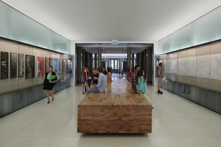 In the Commons area, a 28-foot-long wooden table is crafted from two trees that were cut down to make way for the new addition.