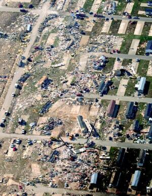 TRAIL OF TRAGEDY: Shown here is a portion of the storm track from the September 2005 Evansville  tornado. Luck plays a major role in tornado events, as homes in the storm's  narrow track may be pulverized while buildings a hundred feet away escape  damage. But strong in-flow winds can also suck poorly anchored manufactured  units off their pads and into the vortex.