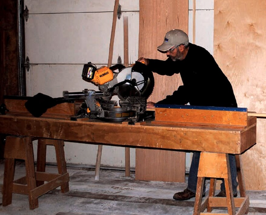 The miter-saw stand sits on a pair of mini-sawhorses and has