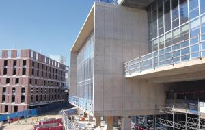 Both the shear wall and balcony cantilever several feet. The concrete for these thick wall and slab placements is integrally colored to achieve a uniform appearance.