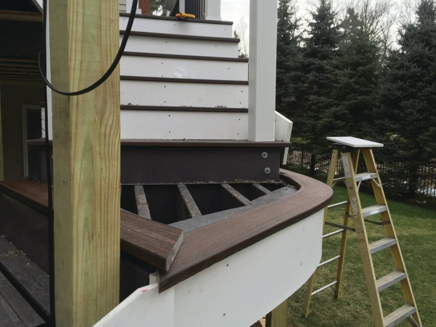 The author used a heating box and a bending table to heat-form the decking for the landing to the proper radius.
