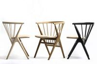Six Iconic Modern Chairs and One Table Get New Life