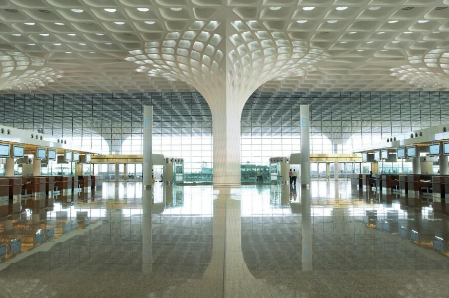 For the 4.4-million-square-foot Terminal 2 at Chhatrapati Shivaji International Airport, in Mumbai, India, Skidmore, Owings & Merrill designed a moment-resisting steel-truss frame that is softened by thousands of precision-made glass-fiber- reinforced concrete panels and gypsum panels.