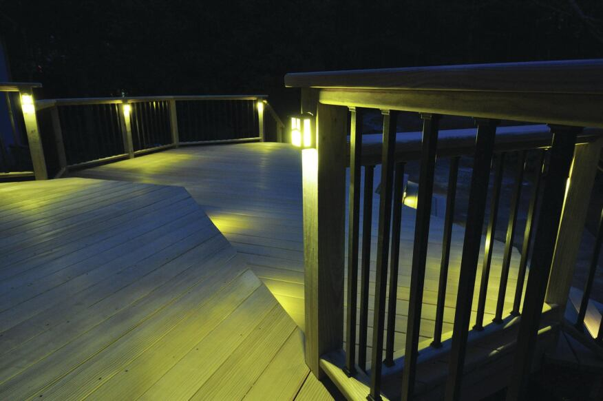 Even though these posts and rails are wood, they're designed to accommodate the electrical wiring needed for deck lighting.