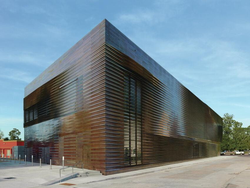On the other three façades, the metal rainscreen from A2MG sits over an air and weather barrier from Henry Co.