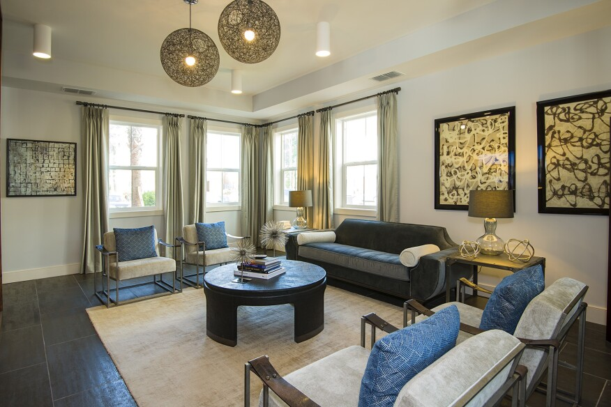 Community amenities at Parkside at The Highlands include a comfortable resident lounge and club room.
