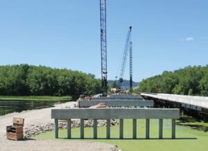 Overview of the completed pile bents with precast pier caps. The temporary bridge is on the right.